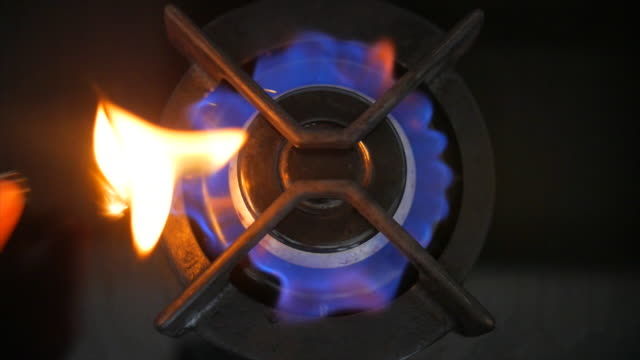 gas burning from a kitchen gas stove in slow motion - stove stock videos & royalty-free footage