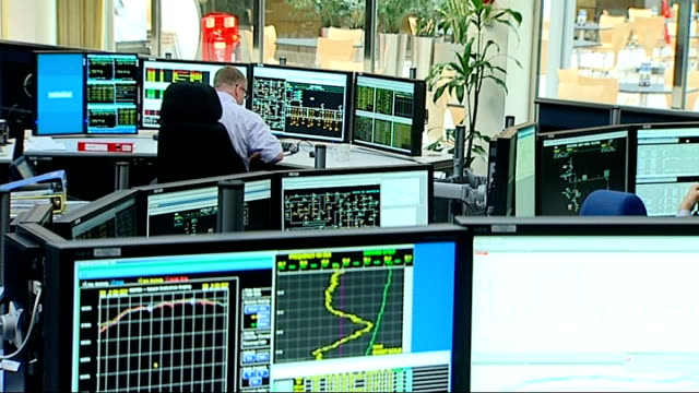 gas companies accused of price fixing r12071112 / reading national grid hq various shots worker at monitors close shot of screen showing 'generation... - grid stock videos & royalty-free footage
