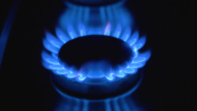 gas cooker hob flame ignites - ignition stock videos & royalty-free footage