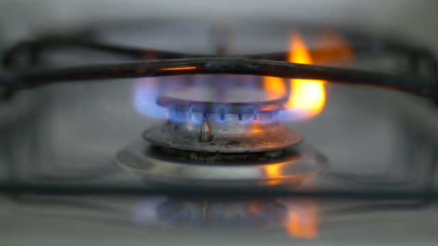 gas cooker ring ignites in slow motion - gas stove burner stock videos and b-roll footage
