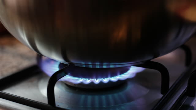 gas flame burning under a pot - cooker stock videos and b-roll footage