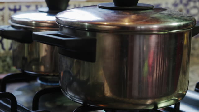 Gas flame burning under a pots