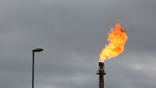 gas is flared off at the grangemouth oil refinery, scotland, uk, which could be regarded as utter waste. - chimney stock videos & royalty-free footage