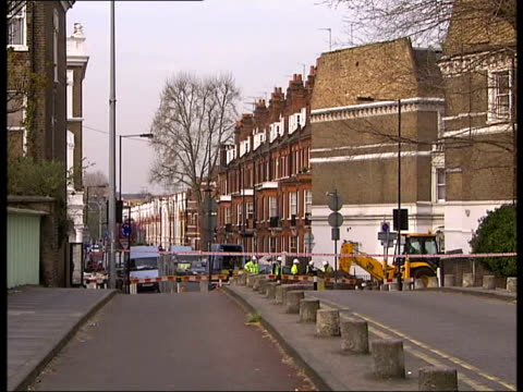 gas leak in hammersmith block of flats; cutaways cordonned off road at site of gas leak gas workers at scene 'road closed' sign - road closed sign stock videos & royalty-free footage
