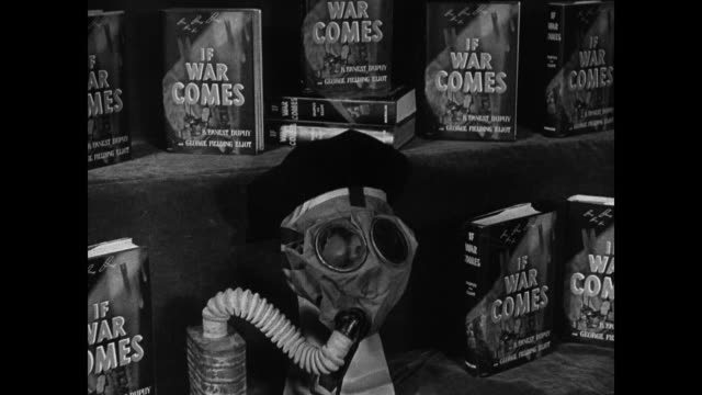 Gas mask amp book 'If War Comes' AERIAL WS Fighter airplanes over mountains CU Chapter in book 'How About the Air' NIGHT CU Antiaircraft canons...