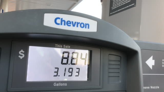 gas meter runs at chevron gas station - refueling stock videos & royalty-free footage