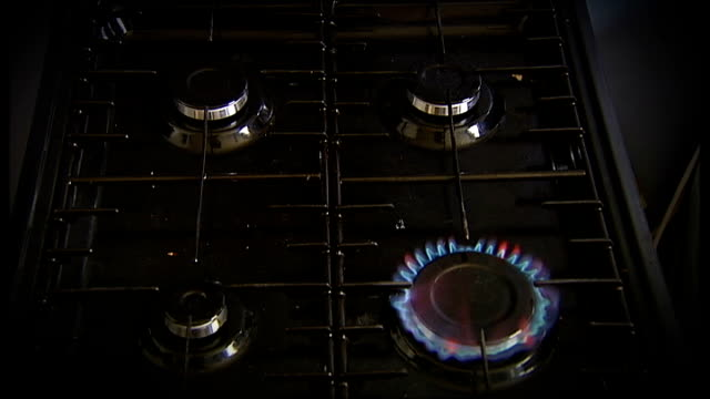 gas ring on cooker hob being lit close up of gas jet burning sequence hand turning off knobs on cooker / gas jets going out on hob graphicised... - knob stock videos and b-roll footage