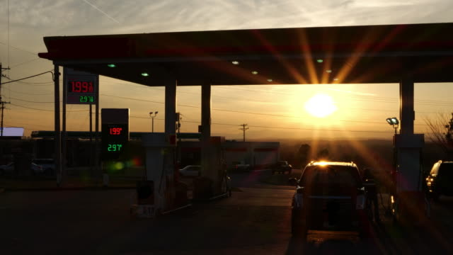 stockvideo's en b-roll-footage met gas station at sunset. - motor oil