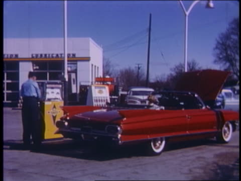 1961 gas station attendant prepares to pump gas into red convertible cadillac with hood open - gas station attendant stock videos and b-roll footage