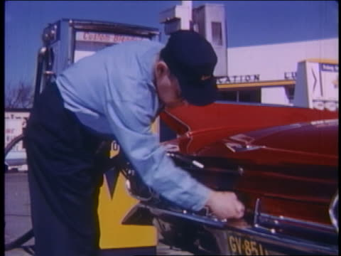 1961 gas station attendant pumping gas into red cadillac - gas station attendant stock videos and b-roll footage