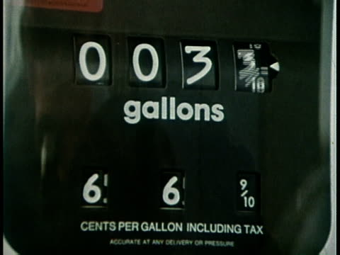 stockvideo's en b-roll-footage met 1977 montage gas station during the oil embargo / usa - 1977