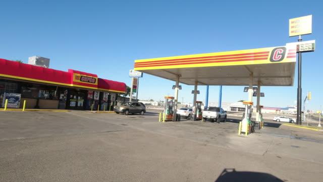 cefco gas station in amarillo, texas, usa opening for business amid the 2020 global coronavirus pandemic - station bildbanksvideor och videomaterial från bakom kulisserna