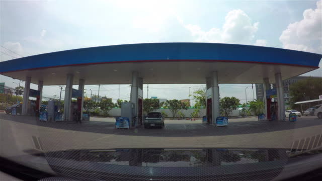 Gas station with clouds sky