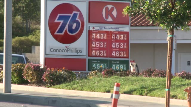 gas stations and pumping gas and gasoline prices, being one of the most expensive in the country gas prices rise on march 15, 2012 in los angeles,... - ガス料金点の映像素材/bロール