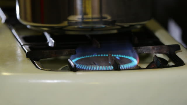 gas stove and pressure cooker. - gas stove burner stock videos and b-roll footage