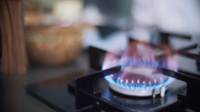 gas stove close-up in professional kitchen - foodie stock videos and b-roll footage