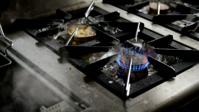 Gas stove with steam in commercial kitchen