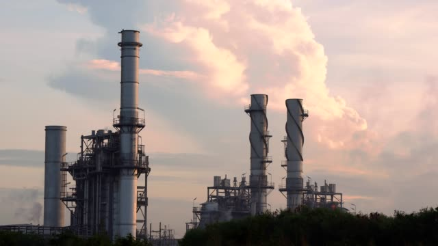 gas turbine electrical power plant at dusk with twilight sky - machine valve stock videos & royalty-free footage