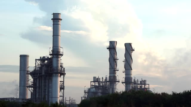 gas turbine electrical power plant at dusk with twilight support all factory - power station stock videos and b-roll footage