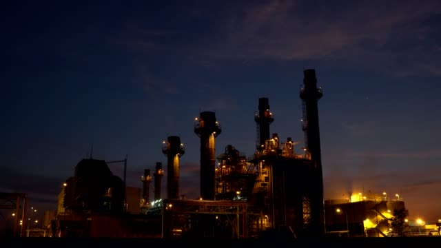 gas turbine electrical power plant at night. - power station stock videos & royalty-free footage