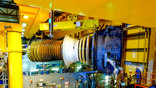 gas turbine rotor installation in combine cycle powerplant - power station stock videos & royalty-free footage