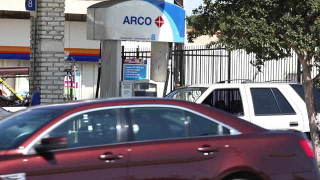 gasoline prices and customers pump gasoline at an arco gas station in torrance california us on sunday july 28 2019 - torrance stock videos & royalty-free footage