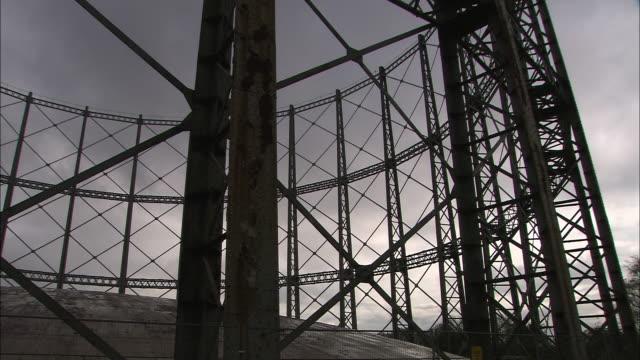 gasometers at gas works under grey clouds, glasgow, scotland - glasgow stock videos & royalty-free footage