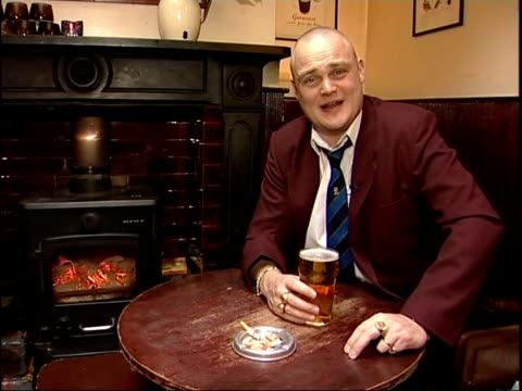 Al Murray's view The Pub Landlord on gastro pubs SOT GVs People served food at table in gastro pub SIDE CS Man drinking pint of beer