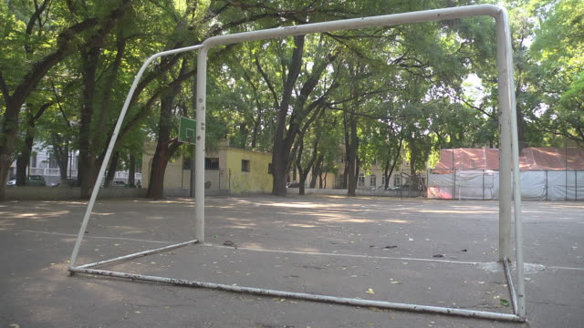 gate at empty football / soccer ground - football pitch stock videos and b-roll footage