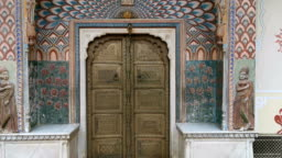 gate door in pink city at City Palace of Jaipur, India