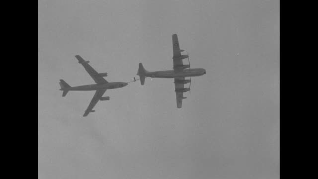 vidéos et rushes de gate entrance to offutt air force base / b-47 stratojet aerial refueling from c-130 / jimmy stewart and general curtis lemay on tarmac / lemay points... - aircraft point of view