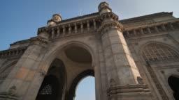 Gate of India in Mumbai against a blue sky