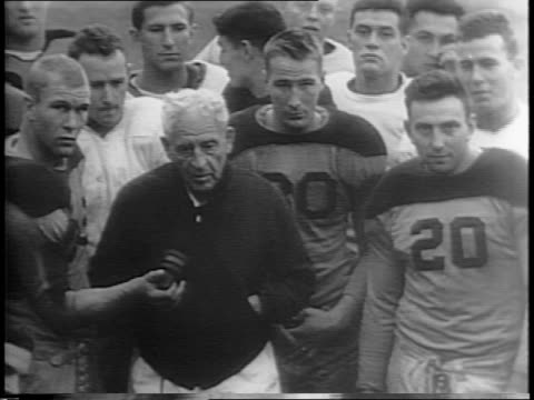 Gate sign for College of the Pacific / people running along campus walk / football Coach Alonzo Stagg surrounded by his players closer view / players...