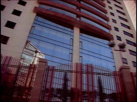 A gate surrounds a modern office building.