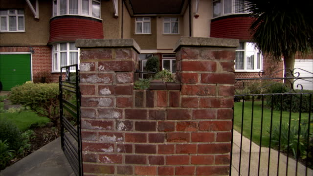 gated pathways lead to semi-detached 1930s houses in the rayners lane district of london available in hd. - doppelhaus stock-videos und b-roll-filmmaterial
