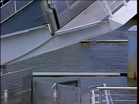 gateshead millennium bridge 'blinking eye' pivots to allow boats to pass underneath - blinking stock videos & royalty-free footage