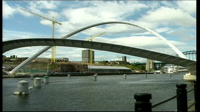 newcastleupontyne ext gvs gateshead millennium bridge over river tyne as tilting from one side to other / gv gateshead millennium bridge slowly... - gateshead stock videos and b-roll footage