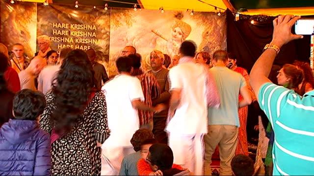 vídeos y material grabado en eventos de stock de 70000 gather in watford for hindu ceremony england hertfordshire watford bhaktivedanta manor people dancing during celebrations of the birth lord... - krishna