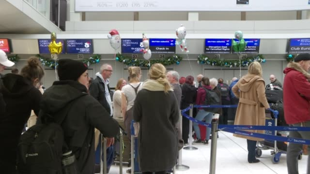 gatwick airport closed by drone activity: military deployed; scotland: glasgow airport: int travellers waiting in queue with luggage airline staff... - gatwick airport stock videos & royalty-free footage