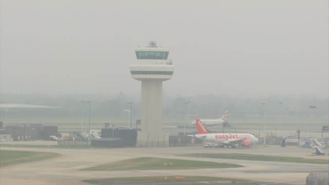 wa gatwick airport, control tower and taxiing aircraft, england - gatwick airport stock videos & royalty-free footage