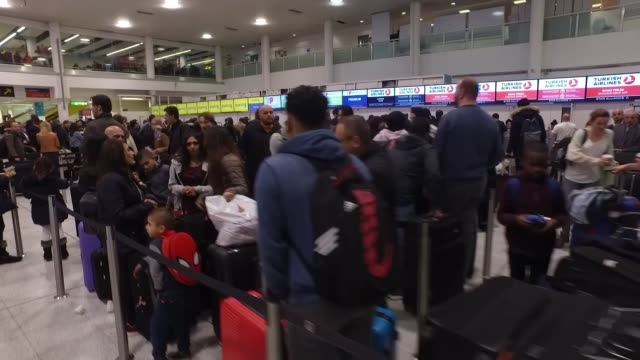 gatwick airport drone incident: police question two people; england: west sussex: gatwick airport: int passengers queueing. - gatwick airport stock videos & royalty-free footage