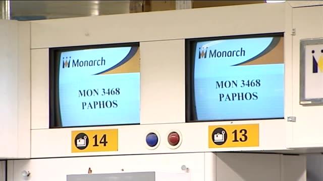 Passengers queuing at Monarch checkin desks Monarch sign / More passengers at checkin desks