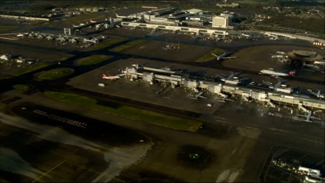 gatwick airport plans for second runway; file: date unknown: london: ext aerial gatwick airport aerial thames estuary - estuary stock videos & royalty-free footage