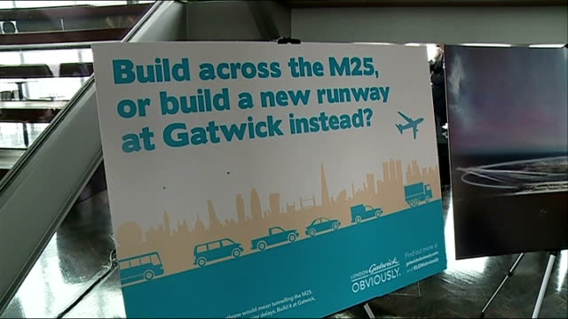 gatwick airport plans for second runway gatwick airport poster promoting new gatwick runway stewart wingate speaking at press conference people... - terry farrell stock videos and b-roll footage