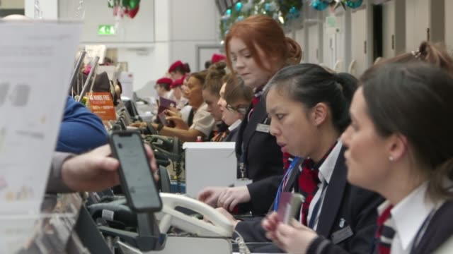 gatwick disruption has knock-on effect on flights across uk and europe; scotland: glasgow airport: int airport staff working at check-in desks - gatwick airport stock videos & royalty-free footage