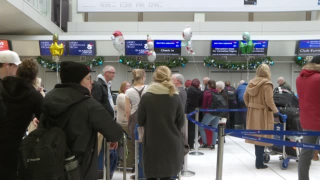 gatwick disruption has knockon effect on flights across uk and europe scotland glasgow airport int travellers queuing at airport checkin desks and... - glasgow international airport stock videos & royalty-free footage