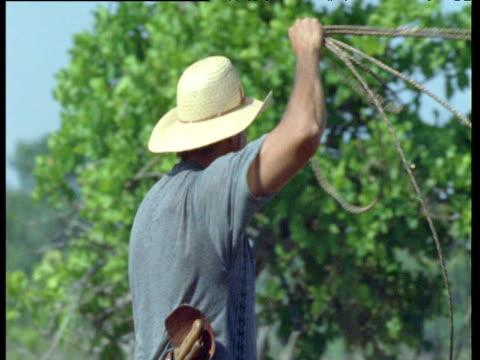 Gaucho herdsman swings lasso on Pantanal