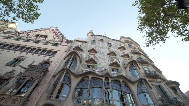 Gaudi Casa Batllo building exterior facade at Barcelona dolly shot