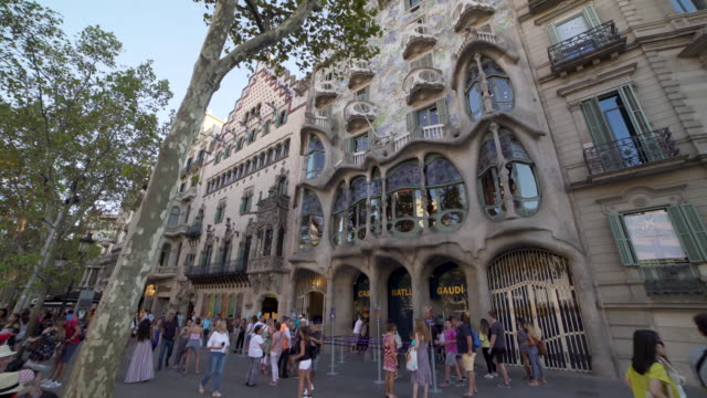 Gaudi Casa Batllo building exterior facade at Barcelona dolly shot