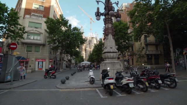 gaudi promenade with sagrada familia dolly shot - スペイン点の映像素材/bロール